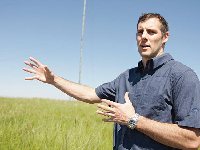 First Wind's Ben Fairbanks standing on a future wind farm. - YOUNG KWAK