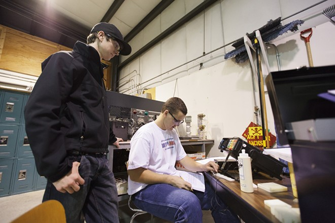 First year students Steven Kresek, right,a nd Adam Searay use an ultrasonic tester non-destructively find the thickness of plastic sheets. - YOUNG KWAK