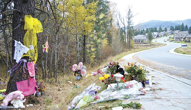 Flowers, photos and ribbons adorn the curve of South Bates Road where Josie Freier and McKenzie Mott died. - JACOB JONES