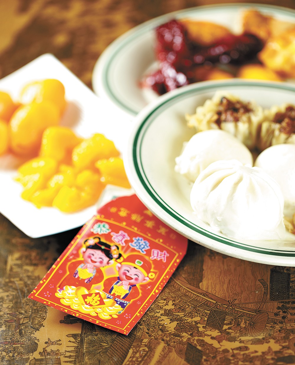 Food from Canaan Buffet, along with the traditional envelopes used to gift money. - YOUNG KWAK