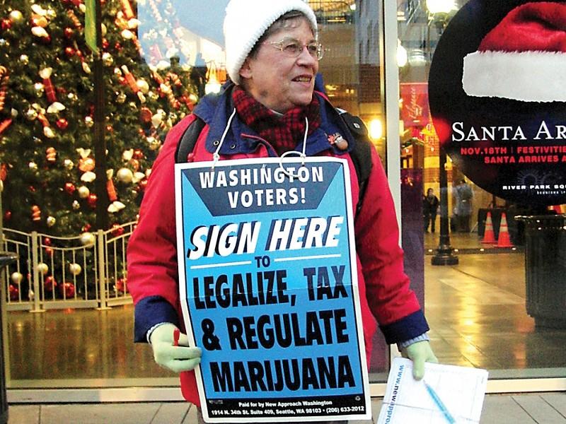 Christine Clark gathering signatures for I-502 in Spokane last November. - NICK DESHAIS