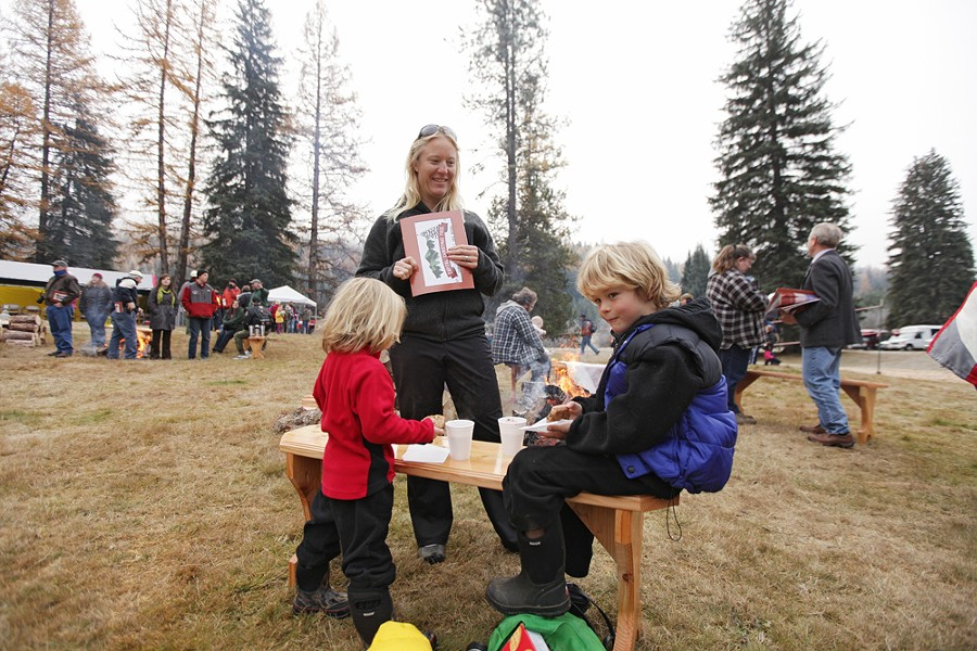 Four-year-old Maggie McClure, left, and her brother Connor, 7, eat cookies and drink hot chocolate, as their mother Erin watches. - YOUNG KWAK