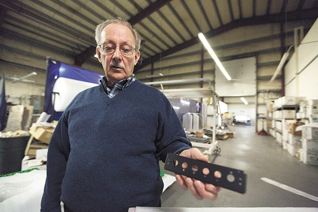 Fred Brown, vice-president of L&M Precision Fabrication, has seen major growth in his company in Spokane County — though he says operations would be much cheaper in Idaho. - YOUNG KWAK