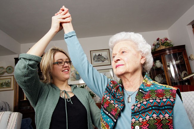 Gentiva Health Services neurorehabilitation director Kristin Rue, PT, NCS, does a stretching exercise with her 89-year-old grandmother Doris Swanson in Spokane. - YOUNG KWAK