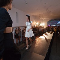 PHOTOS: Olive + Boone Custom Millinery Show Ginger Ewing, left, passes Jessica Bohnhof on the runway. Young Kwak
