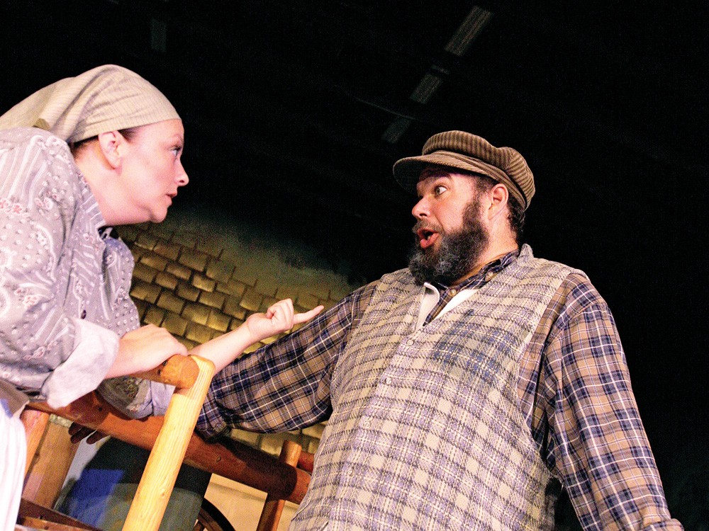 Golde (Renei Yarrow), left, and Tevye (Steve Kane) argue in Fiddler. - YOUNG KWAK
