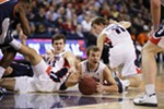 Gonzaga University's Kevin Pangos, center, grabs a loose ball during the second half of an NCAA basketball game against Pepperdine University at the McCarthy Athletic Center on Feb. 7. Gonzaga won 82-56.