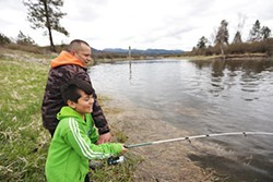 Ray Pierre, vice-chair of the Kalispel tribe, fishes along the Pend Oreille River with his family. - YOUNG KWAK