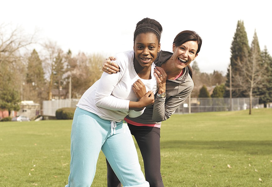 Grant Elementary sixth grader Jada Richardson and mentor Sue Eymann loosen up before a 5k run. - YOUNG KWAK