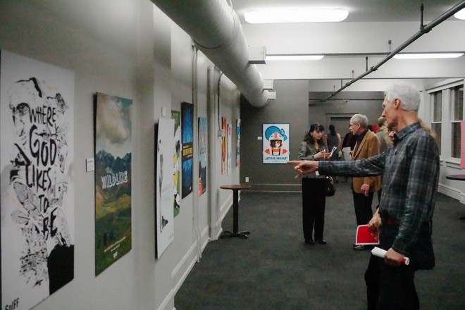 Guests mosey through the movie posters on display. - COURTNEY BREWER