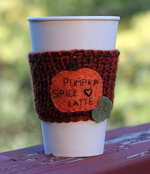 Hand-stitched and knitted cup cozy.