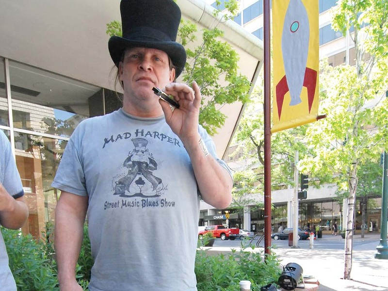 Harpman Hatter's amplified harmonica helped instigate a proposed change in city law. - TAMMY MARSHALL