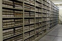 Spokane County deed books in their new home in Cheney. - LISA WAANANEN