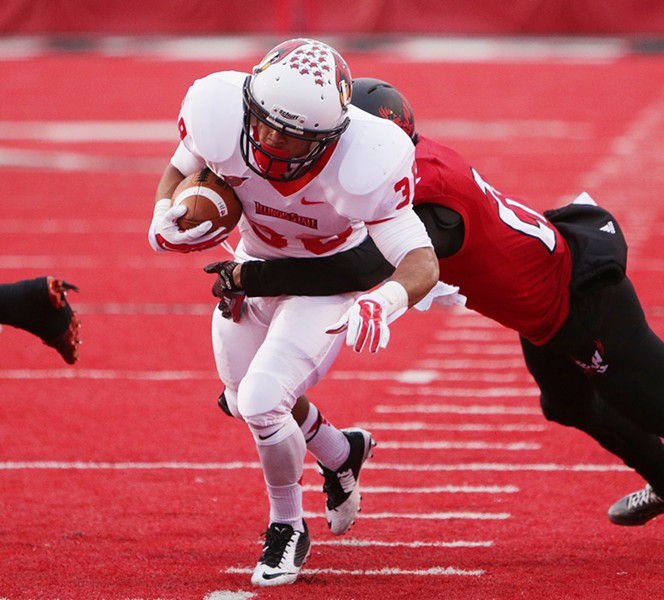 Illinois State running back Jamal Towns (38) avoids a tackle by Eastern Washington defensive back Victor Gamboa (27) during the second half. - YOUNG KWAK