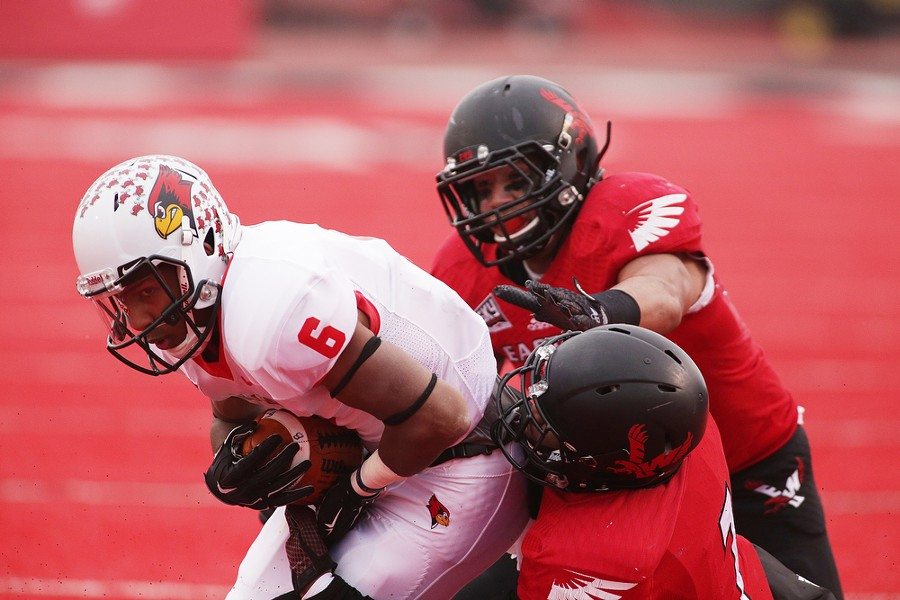 Illinois State wide receiver Jon-Marc Anderson (6) is brought down by Eastern Washington defensive back Tevin McDonald (7) during the first half. - YOUNG KWAK