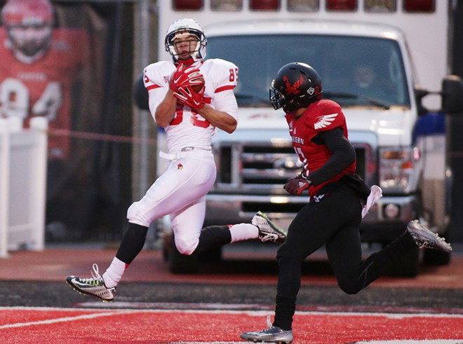 Illinois State wide receiver Lechein Neblett (85) catches a pass he runs in for a touchdown against Eastern Washington defensive back Victor Gamboa (27) during the second half. - YOUNG KWAK