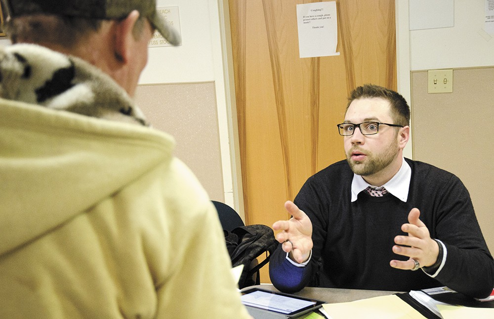 In-person assister Matthew Olson helps a homeless man enroll in Obamacare. - JACOB JONES