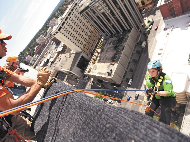 Inlander staffer Jordy Byrd gives a terrified smile as she dangles from the Bank of America building. - YOUNG KWAK