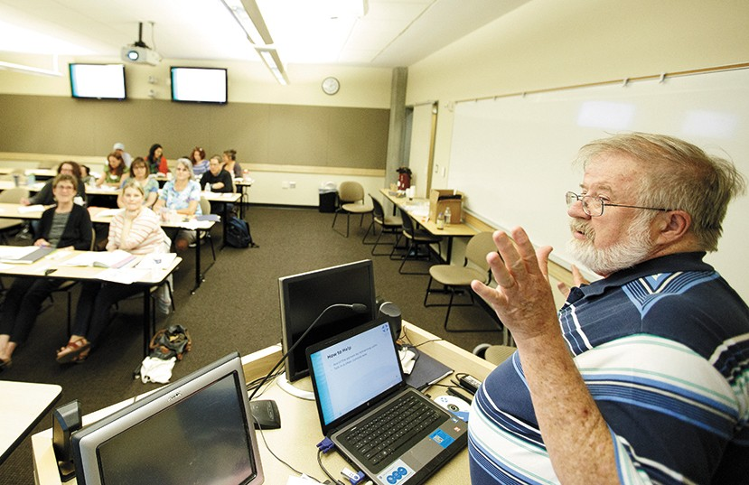 Instructor John Murphy speaks with his class during a Mental Health First Aid training. - YOUNG KWAK