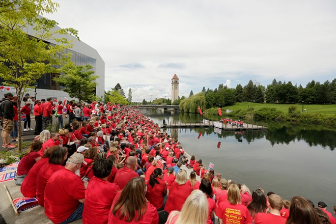 Teachers and other school staffers from East Valley and Spokane Public Schools gather in Riverfront Park to protest education funding policies - YOUNG KWAK