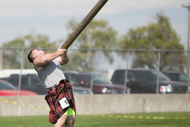 Jacob Masterson tosses a caber during the men's amateur A & B competition. - YOUNG KWAK