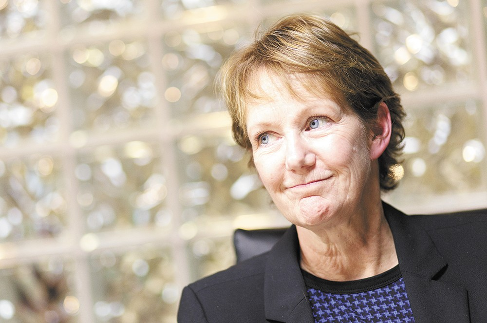 Jan Quintrall, Spokane's embattled division director of Business and Development services, resigned after criticisms of her fine dining at an upscale club. - YOUNG KWAK