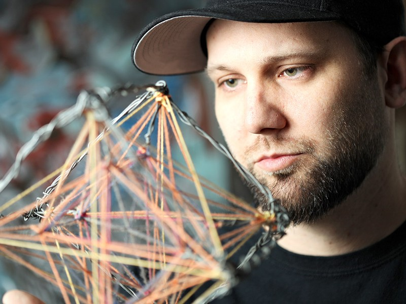 Jason Corcoran holds an untitled Metatron\'s cube. - YOUNG KWAK