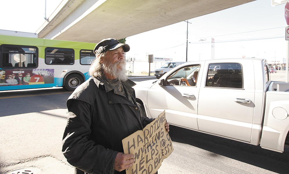 Jeffery Mitchell Reid panhandles at the intersection of Jefferson and the I-90 on-ramp in Spokane.| - YOUNG KWAK