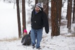 Jeremy Swanson pulls his daughter Saveena, 5, on a sled at Underhill Park.