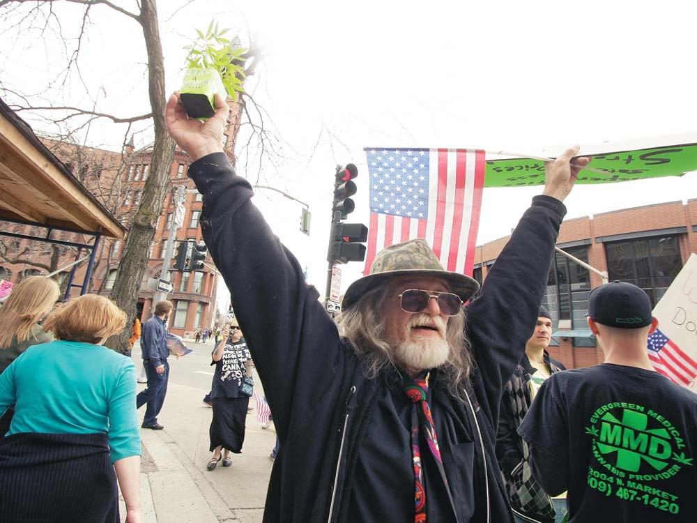 Jerry Laberdee during a protest against last week's raids in front of Spokane's federal courthouse. - YOUNG KWAK