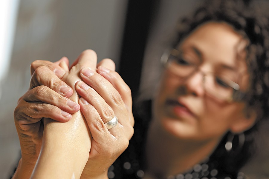 Jill Turner, salon trainer at The Spa Coeur d'Alene, helps clients combat winter ravages on their hands. - YOUNG KWAK