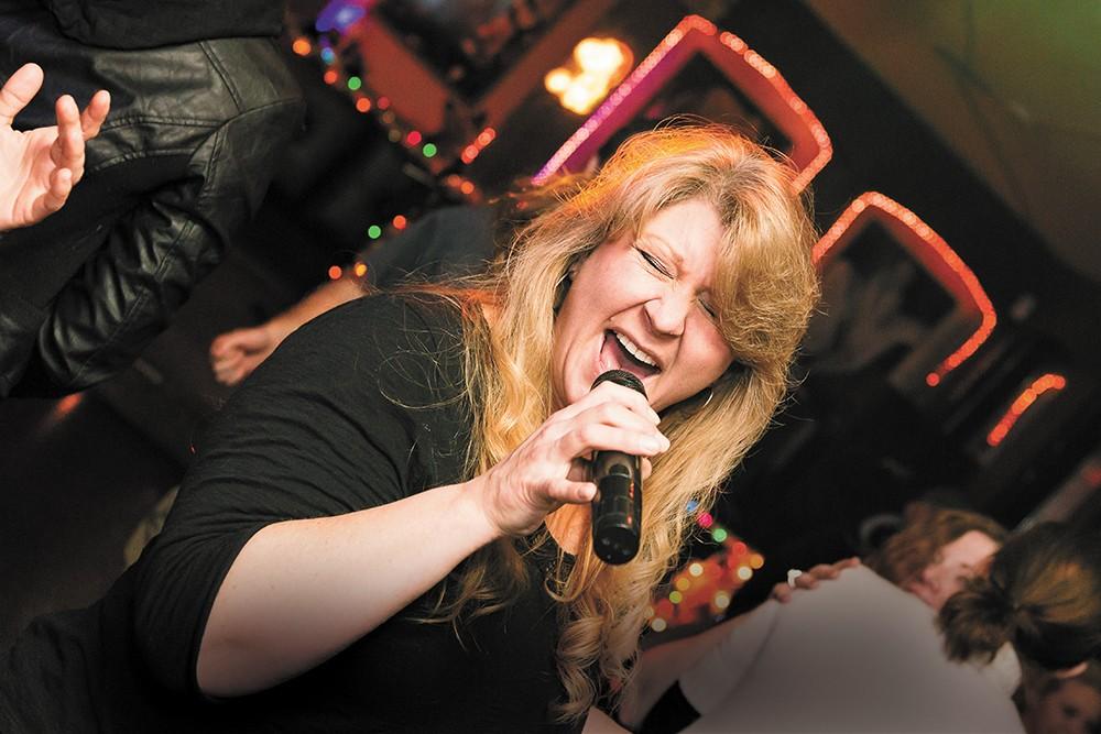 J.J. White belts out a karaoke tune at Studio K. - STEPHEN SCHLANGE
