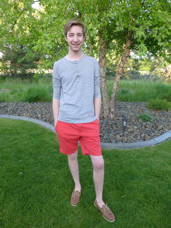 John Akers, Spokane native, is wearing two of our summer trends: boat shoes and colored shorts. - MADISON BENNETT