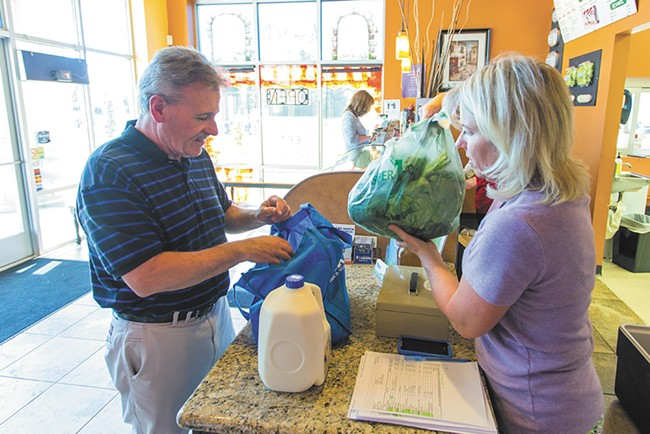"""John Christman is Shelly Stevens """"number one customer."""" Christman buys fresh produce, meats and eggs from Stevens every week. - MATT WEIGAND"""