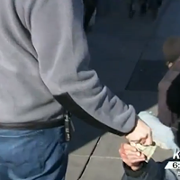 Meet the guy who's giving away thousands of dollars in cash to the homeless in Spokane