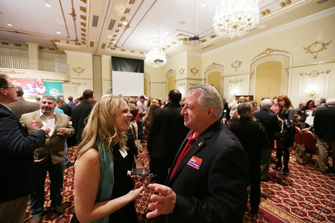 Julie Shiflett, left, speaks with Spokane County Commissioner Al French (R). - YOUNG KWAK