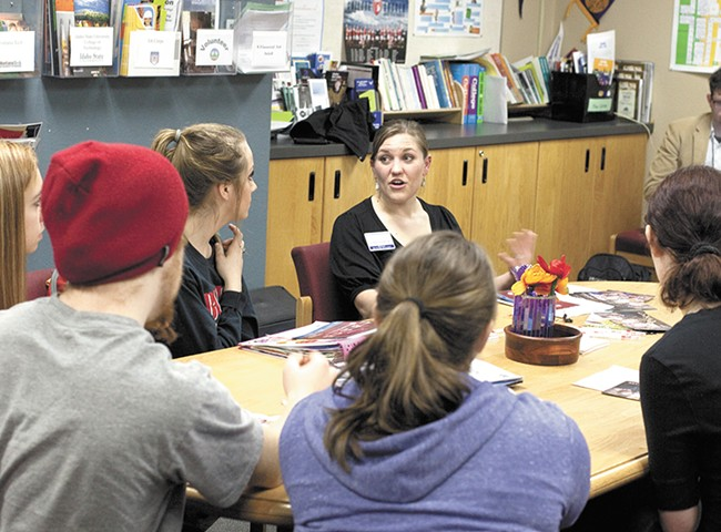 Justene Garner, from Lewis-Clark State College, walks Sandpoint High students through the list of things they need to enroll in college. - ANNIE KUSTER