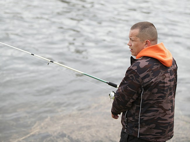 Kalispel tribal vice-chair Ray Pierre fishes along the Pend Oreille River near Cusick, Wash. - YOUNG KWAK