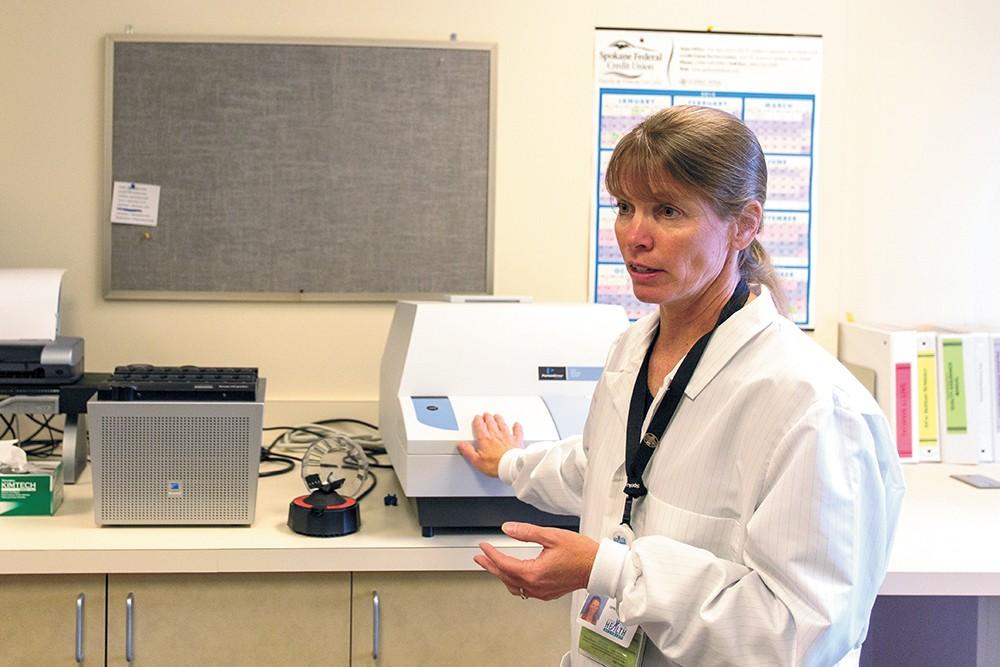 Karie Brouillard is the lead microbiologist at the Spokane Regional Health District's bioterrorism lab. - MATT WEIGAND