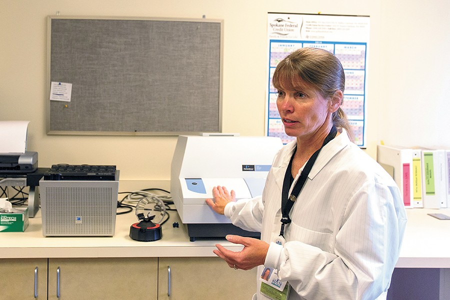 Karie Brouillard is the lead microbiologist at the Spokane Regional Health District's bioterrorism lab. - MATT WEIGAND