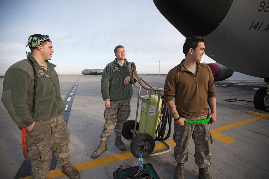 (Left to right) 376th Expeditionary Aircraft Maintenance Squadron Airman First Class Joshua Jones, Airman First Class Mark Plott and Senior Airman Nick Stevens wait for a crew to arrive at a KC-135, on alert status. - YOUNG KWAK