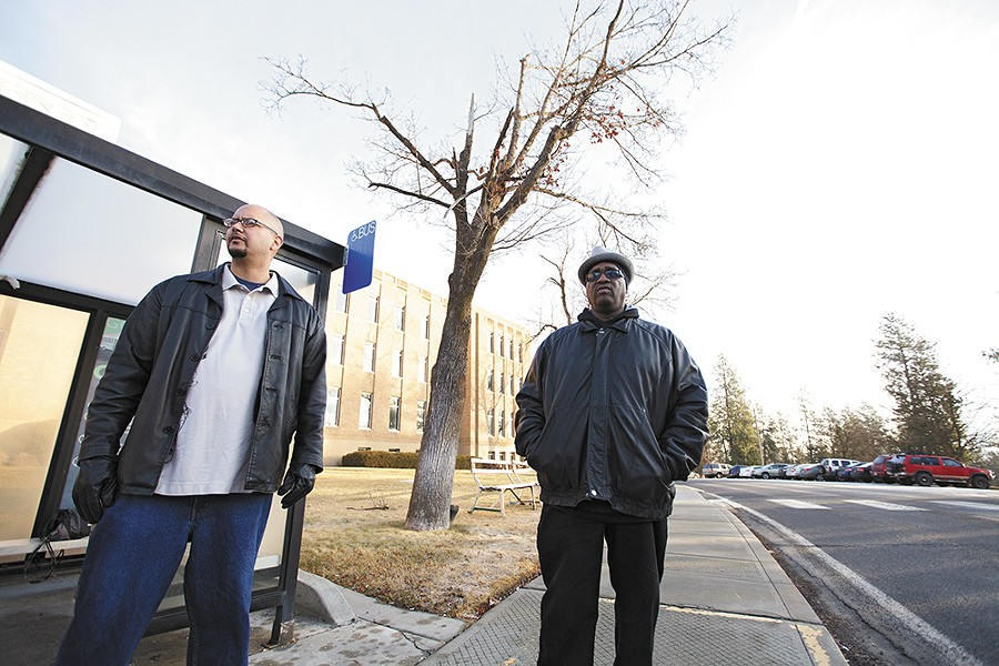 "Ketema Ross, left, and David ""DB"" Brent wait for a bus near Eastern State Hospital in January, after receiving court permission to attend Narcotics Anonymous meetings in downtown Spokane. - YOUNG KWAK"