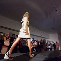 PHOTOS: Olive + Boone Custom Millinery Show Kimberly Edwards walks the runway. Young Kwak