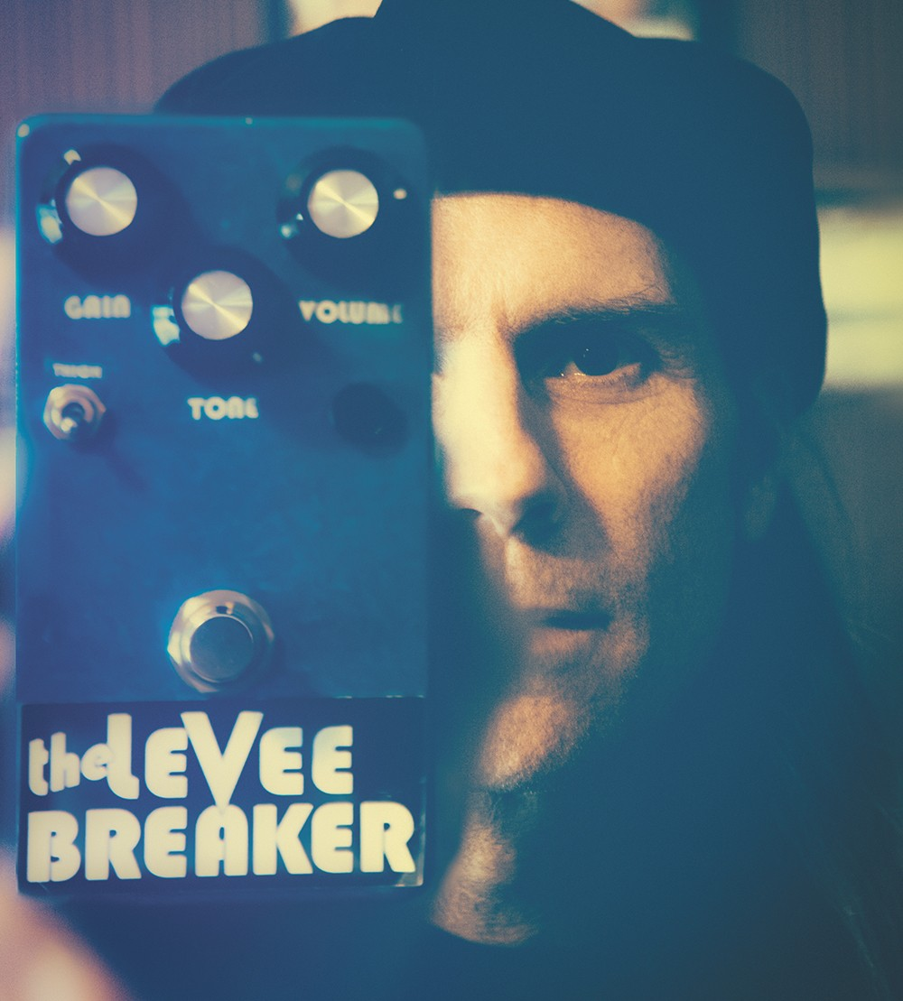 Kit Ehrgood shows off a prototype for a new guitar pedal he's developing. - KRISTEN BLACK