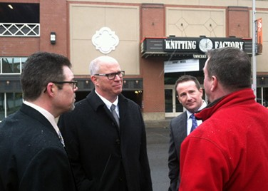 Knitting Factory COO Greg Marchant, center, and other company representatives chat with the media. - LISA WAANANEN