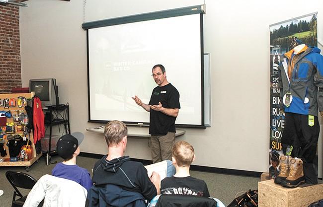 Kurt Perrigo discusses preparing for a winter camping trip during a class at the Spokane REI. - MEGHAN KIRK
