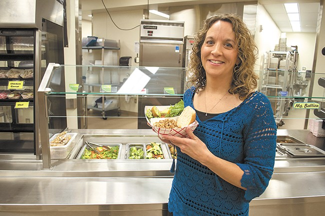 Laura Martin (left), the wellness coordinator at Cheney Middle School, shows off a healthy school lunch. - SARAH WURTZ