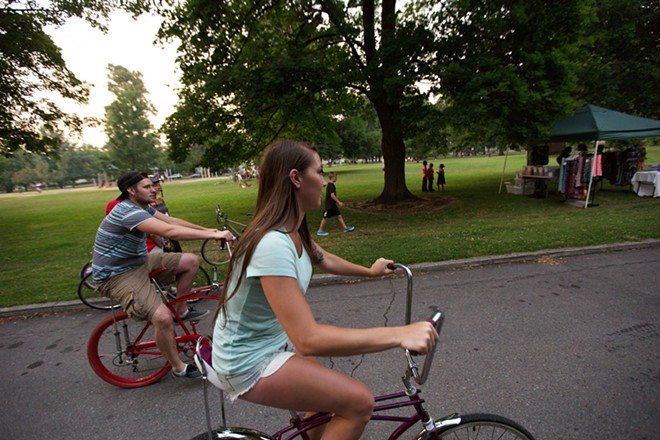 Lauren Stewart, center, and Will Dewey ride the parkway. - YOUNG KWAK