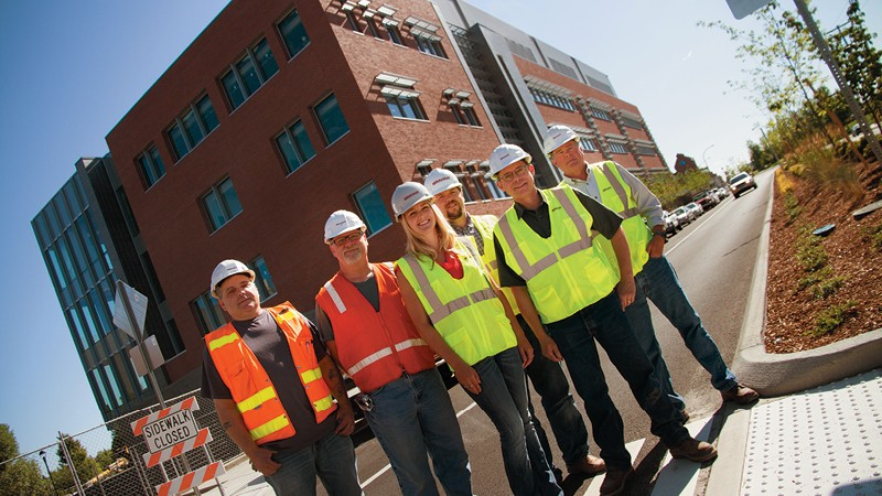 (Left to right) Bob Cross, Carl Clausen, Karlee Agee, Scott McGlocklin, Regie Brusell and Bob Askins stand in front of the new WSU BioMed building that they helped create. - JENNIFER DEBARROS