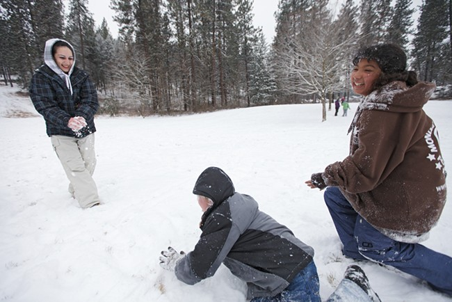 (Left to right) Josie Leyba, Samuel Bakken and Nessa Trevino have a snowball fight at Underhill Park. - YOUNG KWAK